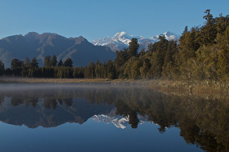 Reflection lake at Lake Matheson Fox Glacier Sout  Island New Zealand