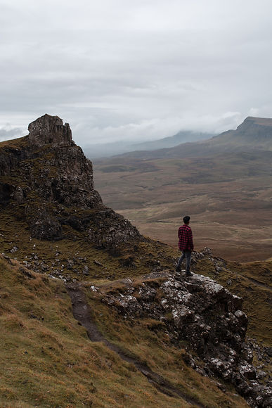 Canva - Man  Standing on Rock Mountain.j