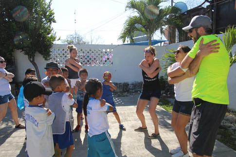 Playing games with the kids at community service 1