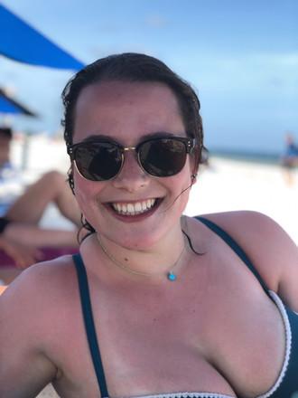 Happy participant Alex at the beach
