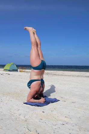 Alex headstand at the beach