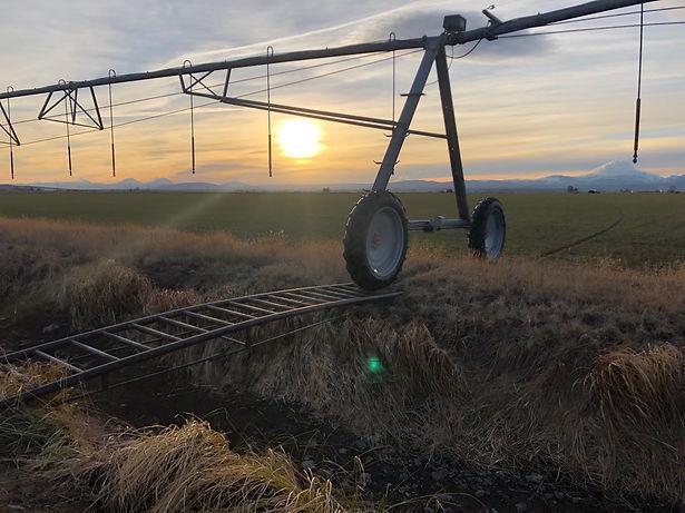 pivot system over irrigation canal bridg