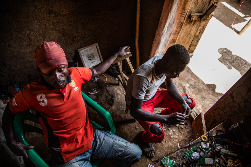 Residents repair old electronics to get money.