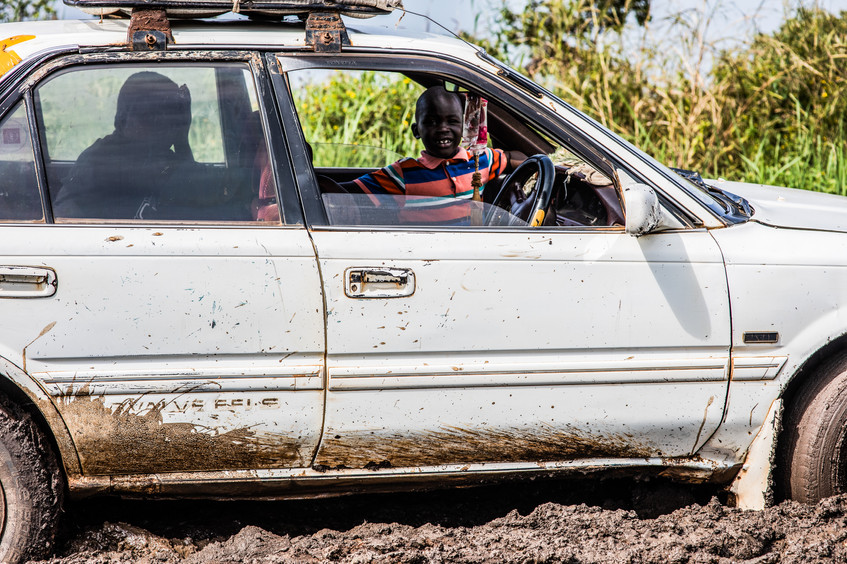 A car on it's way to border  to pick up something and is being stuck in a mud.