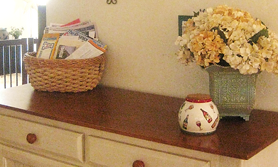 A basket catches mail that piles up. Pick your spring cleaning battles.