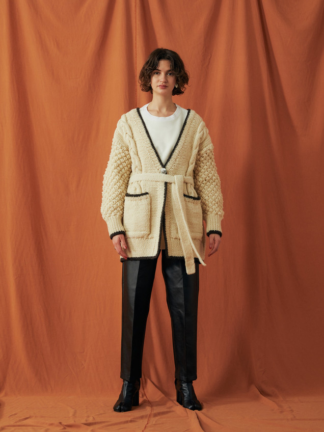 Hand knitting Cardigen ¥28,000+tax. Hot-Thermal Tops ¥14,000+tax. PU Leather pants ¥22,000+tax.