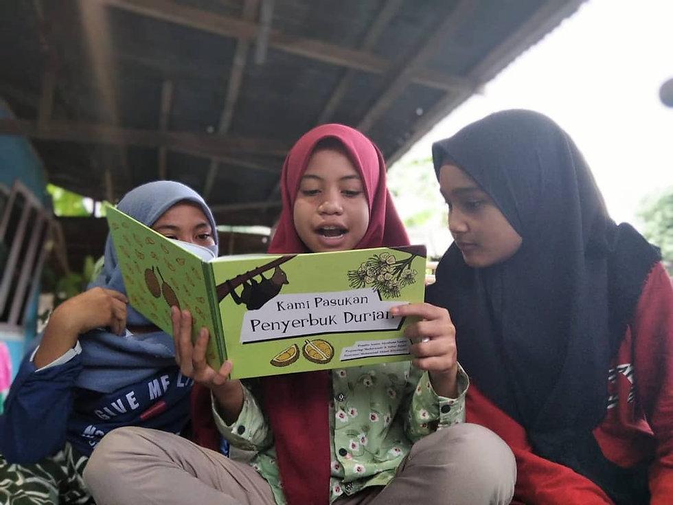 Children in the village reading about bats.jpg