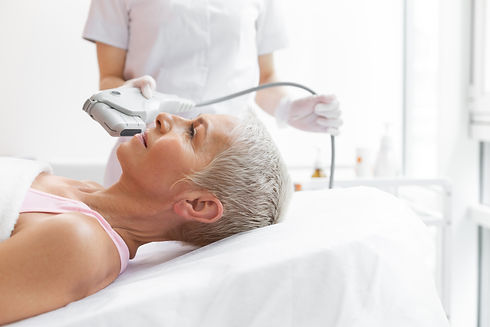 Facial treatment. Nice grey haired woman