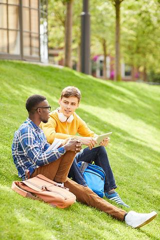 students-sitting-on-green-lawn-MJH7U5E.j