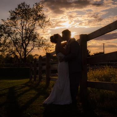 Wedding Sunset photo on the fence
