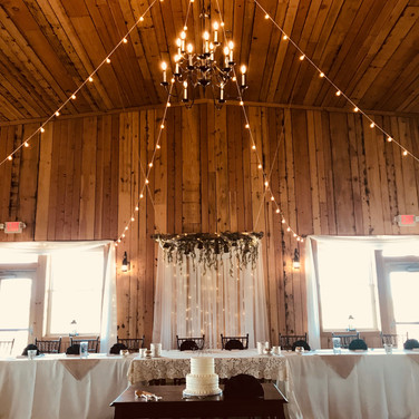Head table with decorations by Garland & Lace