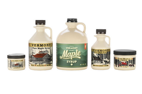 Five different sized beige maple containers with green, grey, and gold labels that say Vermont Maple