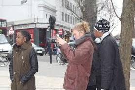 Teenagers filming in the street