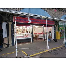 Shop window of Sheperds Bush Halal Meat butcher