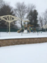 playground in the winter with snow on the ground at Jolly Toddlers Early Childhood Education Center