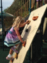 Preschooler climbing at Jolly Toddlers Early Childhood Education center in Bucks County PA
