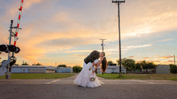 Bride and Groom pose by Kingsville's Ice House Venue