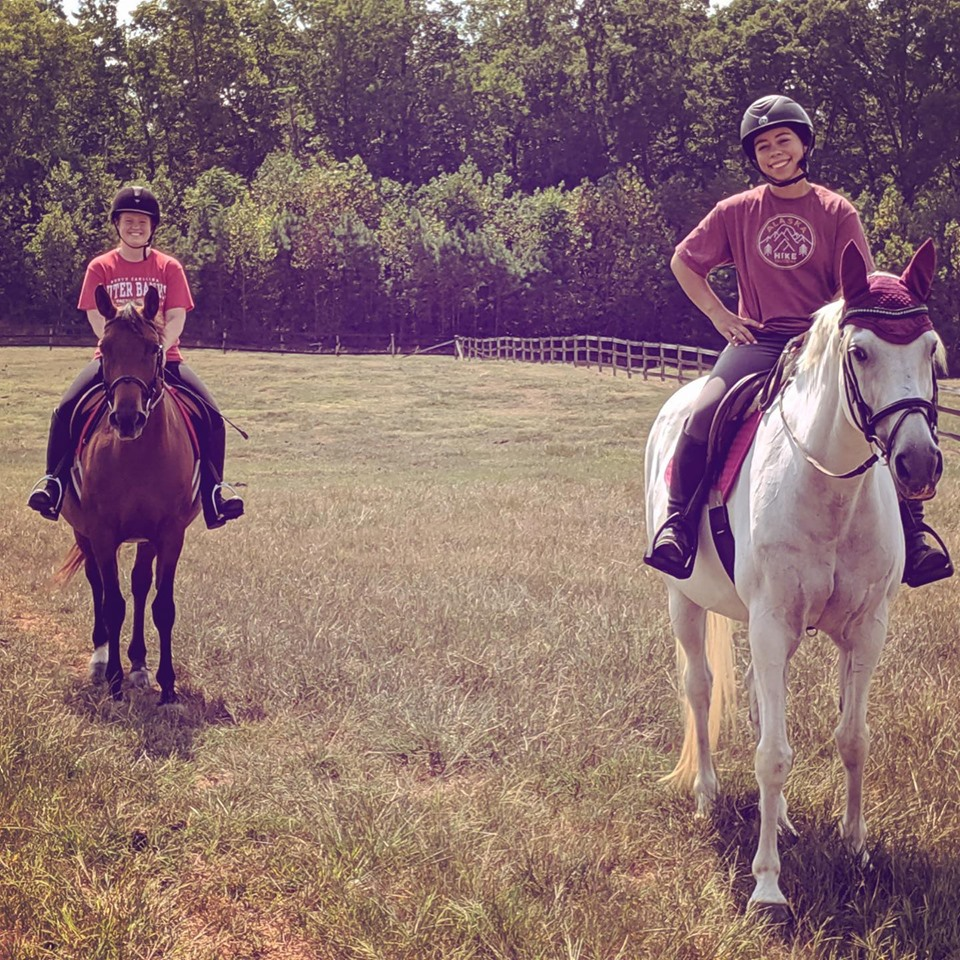 Juno and Sky out on a trail ride
