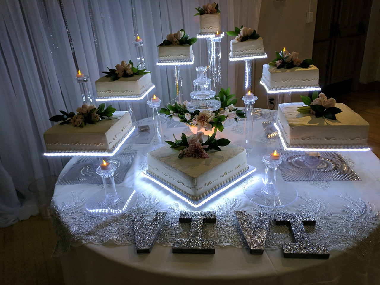 Quincerea Cake with Lighted Cake Bases.j