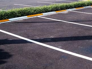 parking-lane-concrete-road-empty-car-parking-lot.jpg
