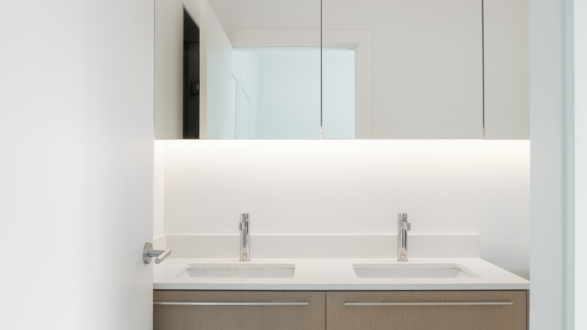modern bathroom vanity with led mirror and penny round tile by untitled design agency