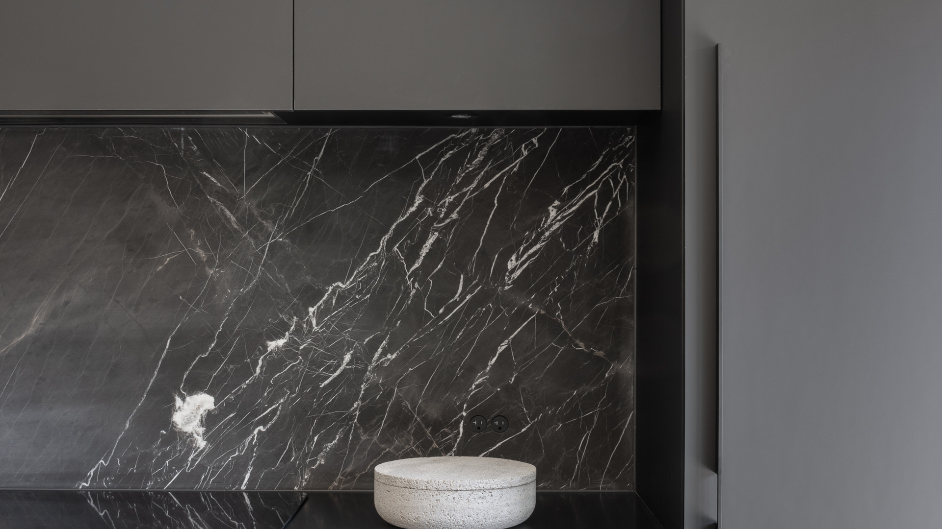 modern black and white kitchen with marble backsplash by untitled design agency