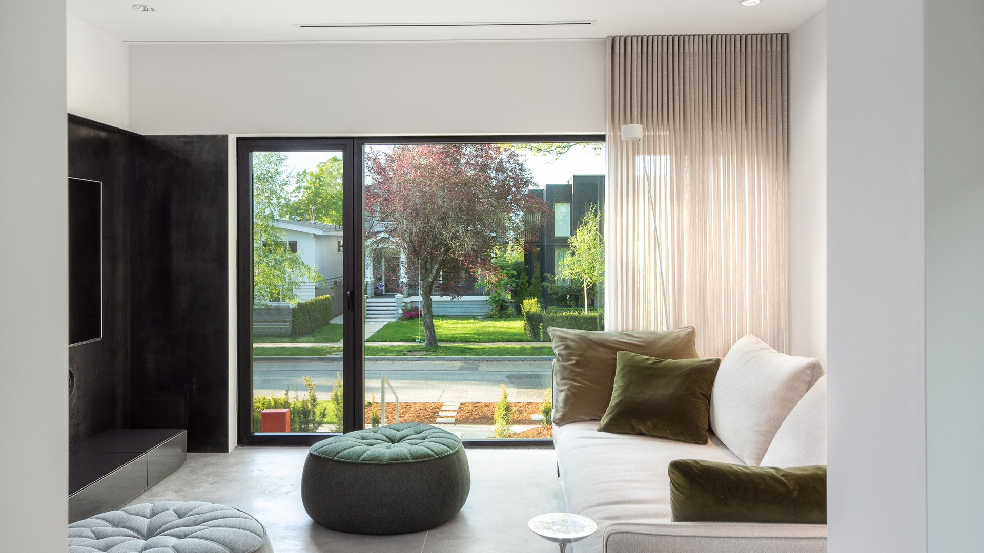 modern living room with molteni paul sofa with ligne roset ottoman and davide groppi lamp by untitled design agency