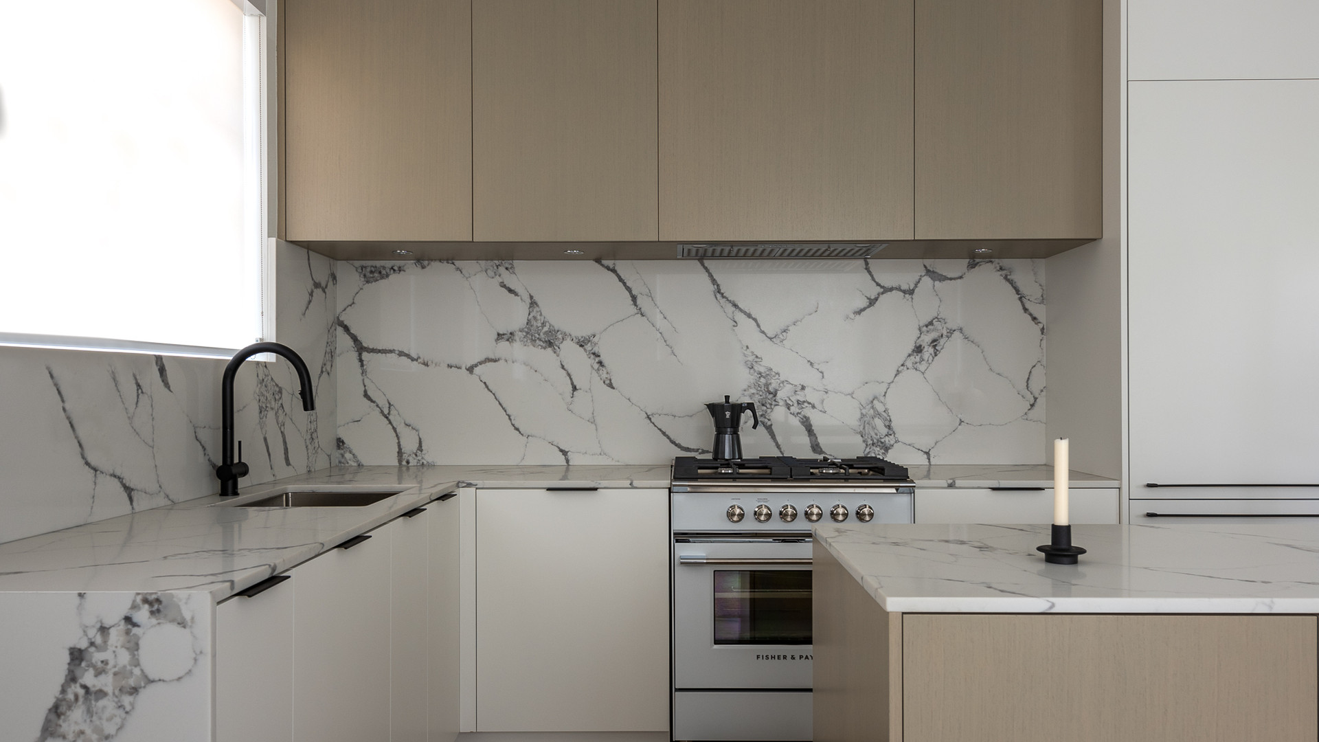 modern kitchen with oak cabinet doors and marble backslpash by untitled design agency