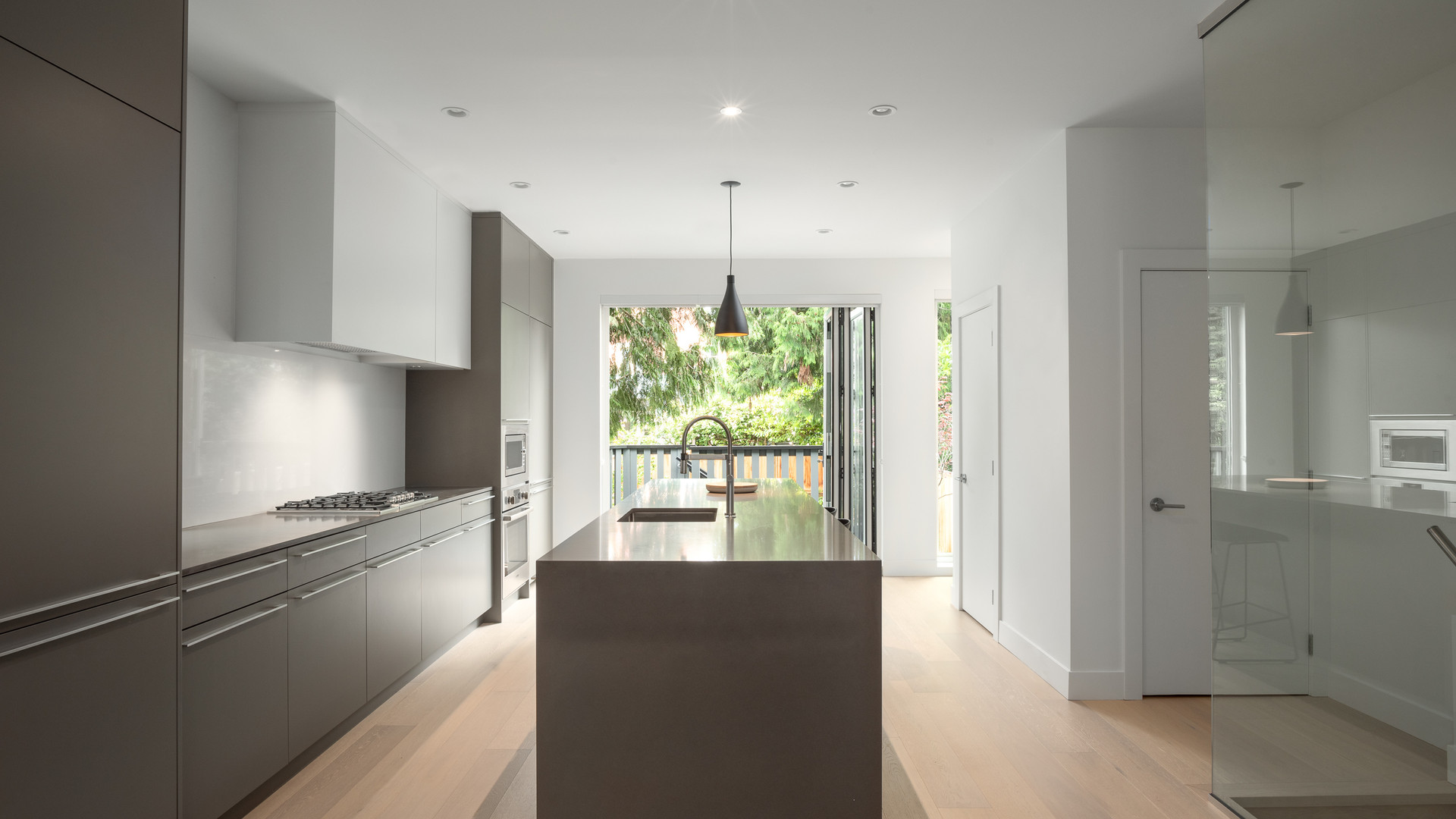 modern grey kitchen with island by untitled design agency