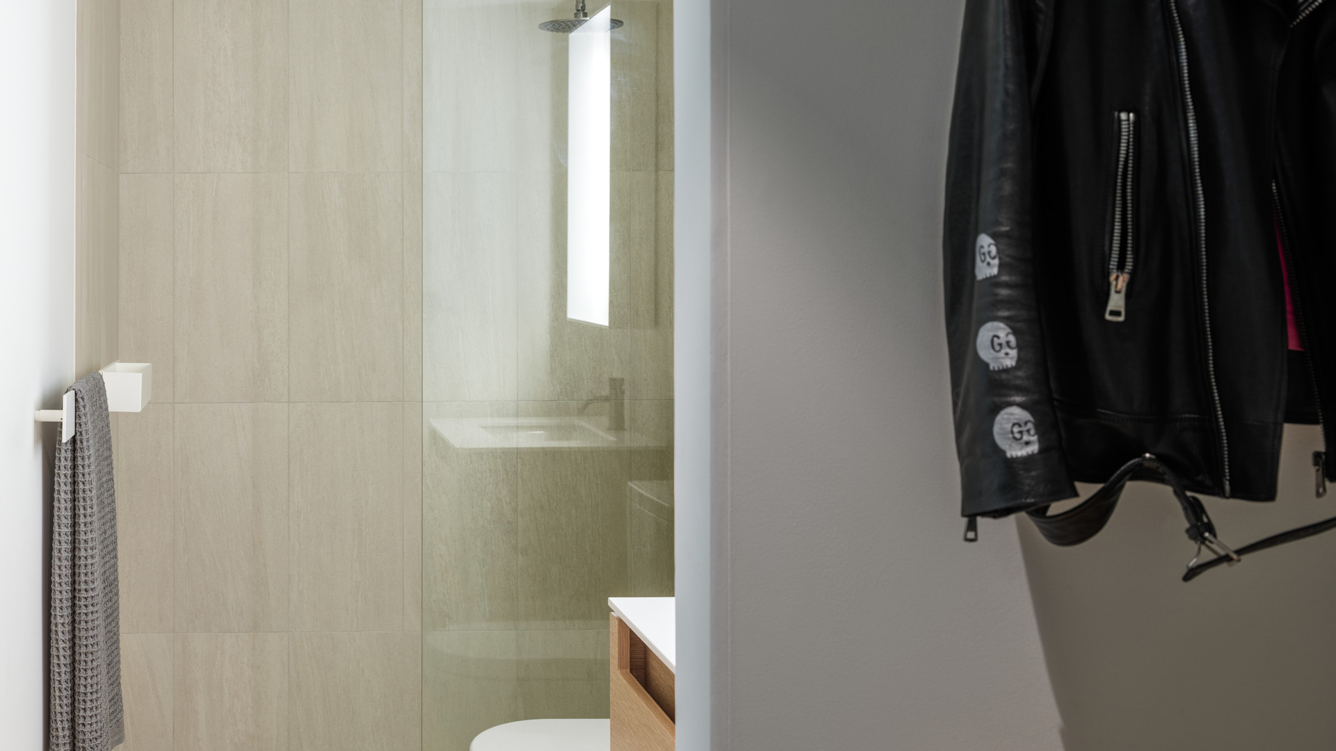 modern ensuite bathroom and closet by untitled design agency