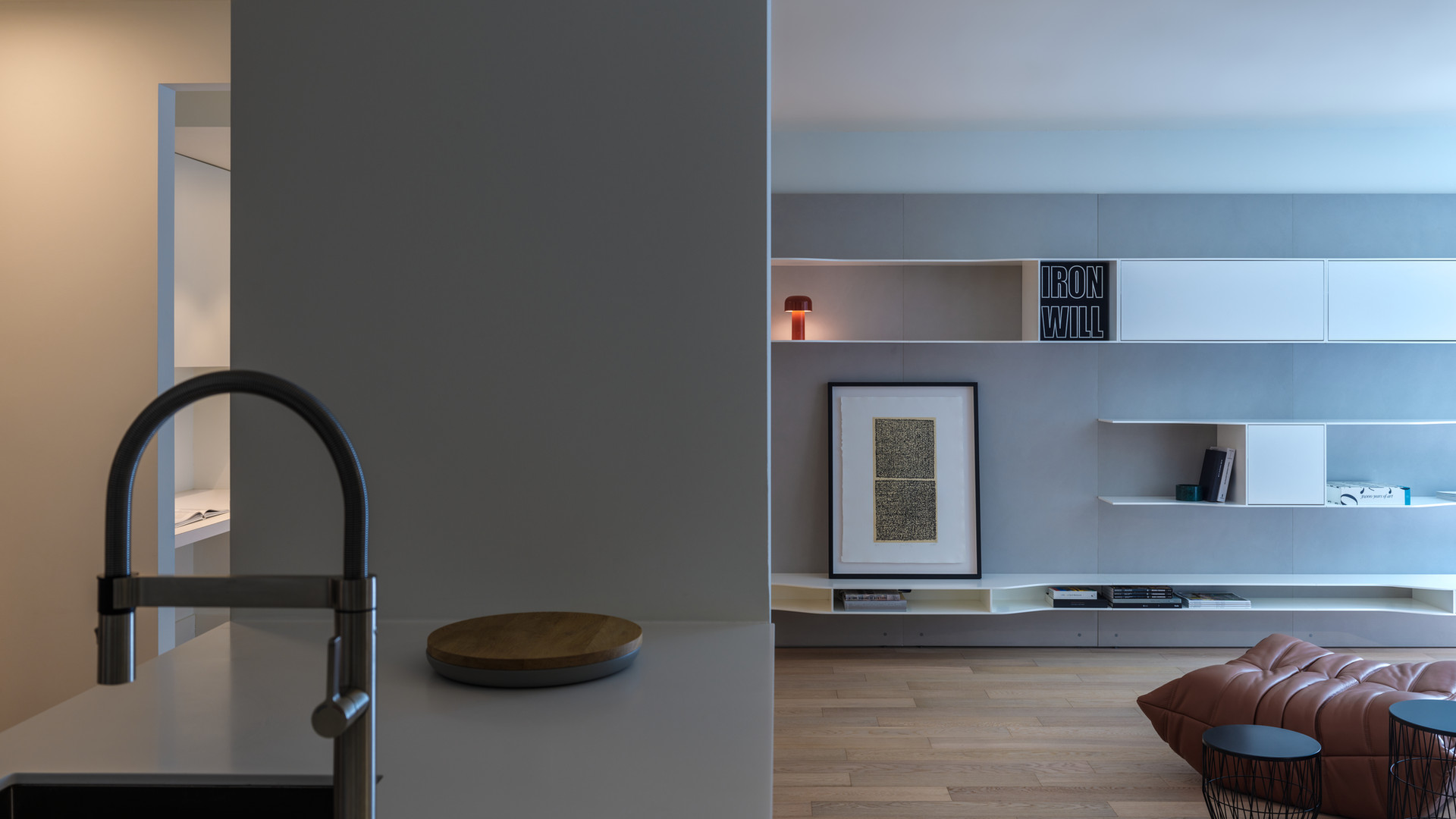 modern kitchen and living room with mdf italia bookshelf and ligne roset togo sofa by untitled design agency