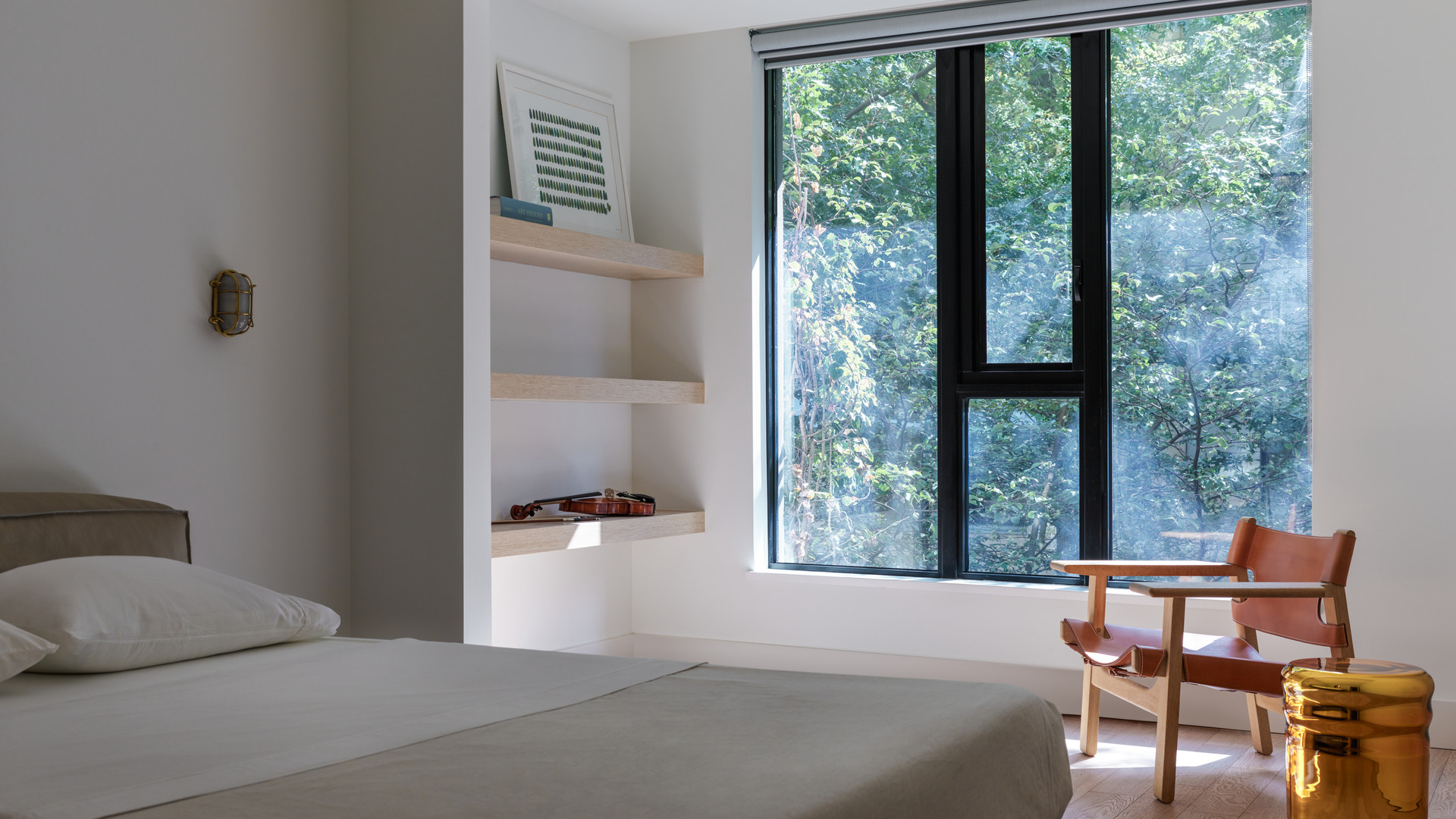 modern bedroom with borge mogensen spanish chair by untitled design agency