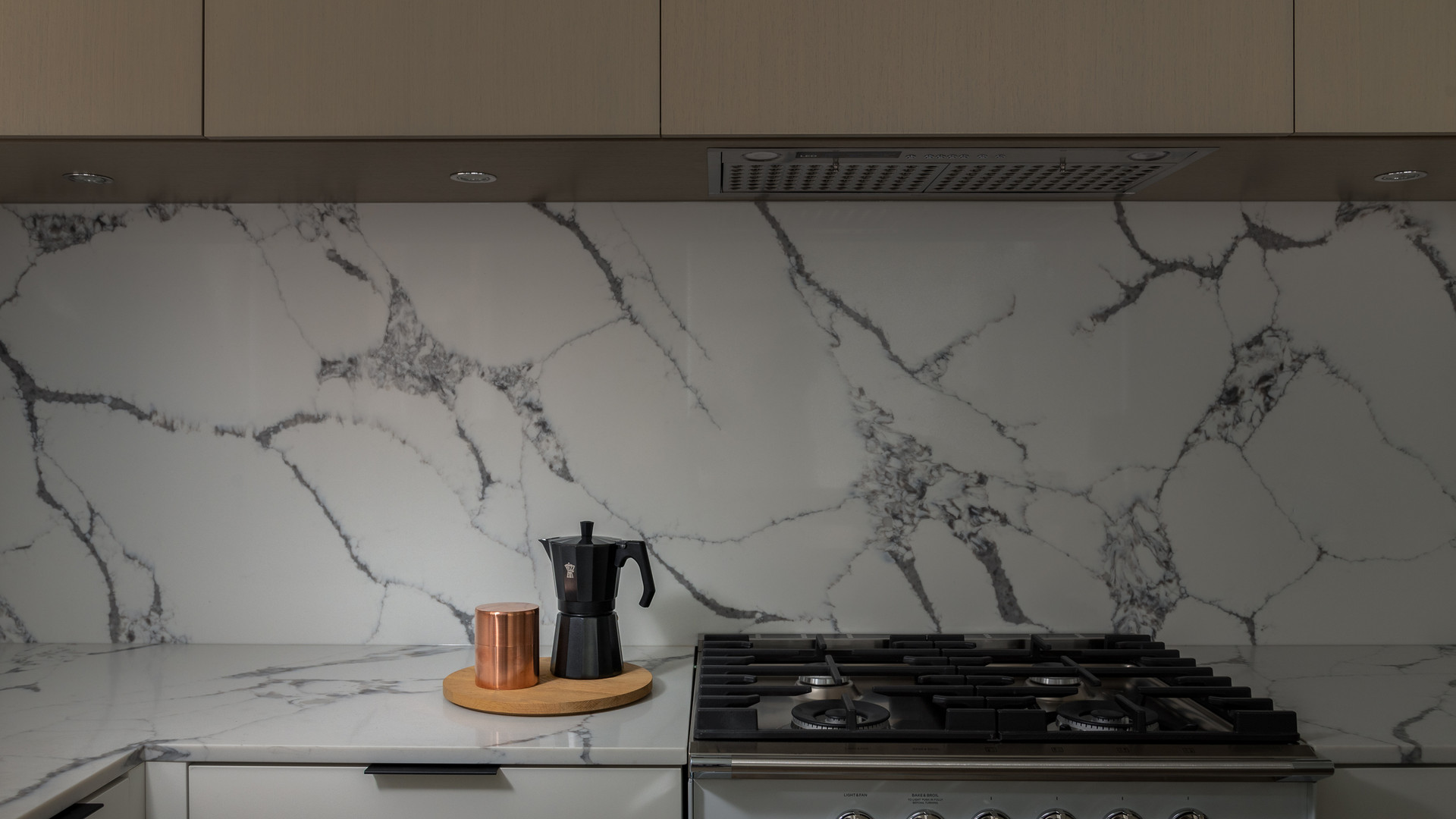 modern kitchen with oak cabinet doors and marble backsplash by untitled design agency