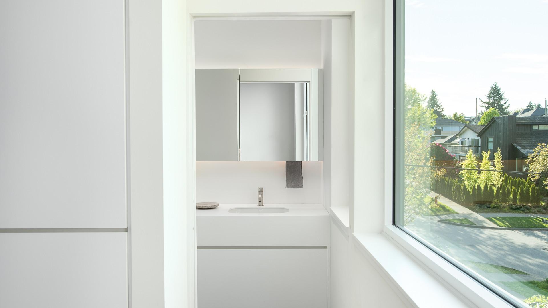 modern ensuite bathroom vanity with led mirror by untitled design agency