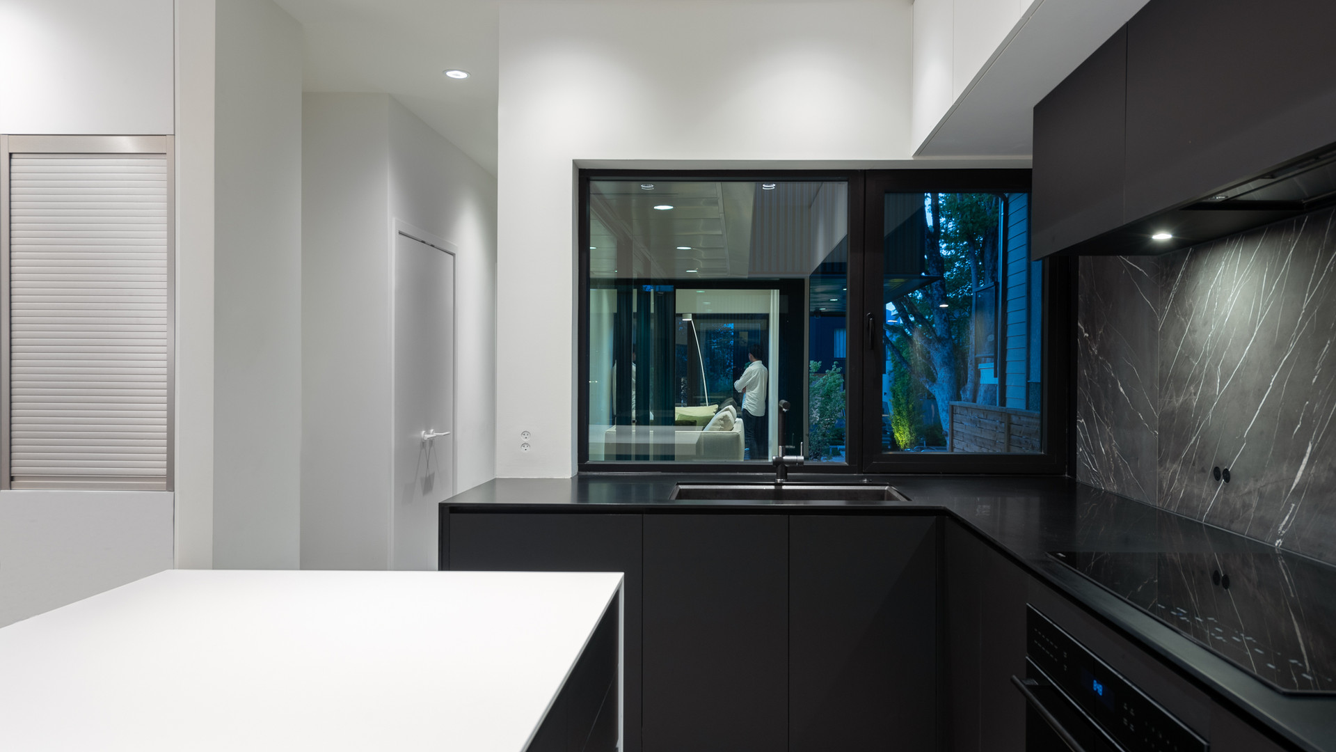 modern black and white kitchen and pantry by untitled design agency