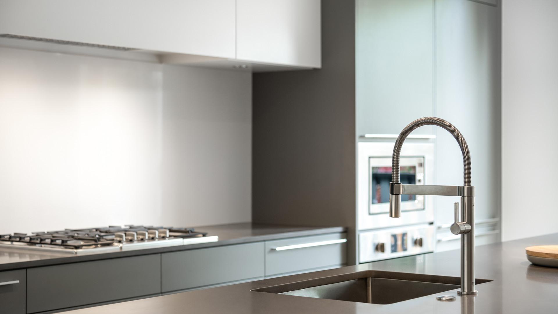 modern grey kitchen by untitled design agency