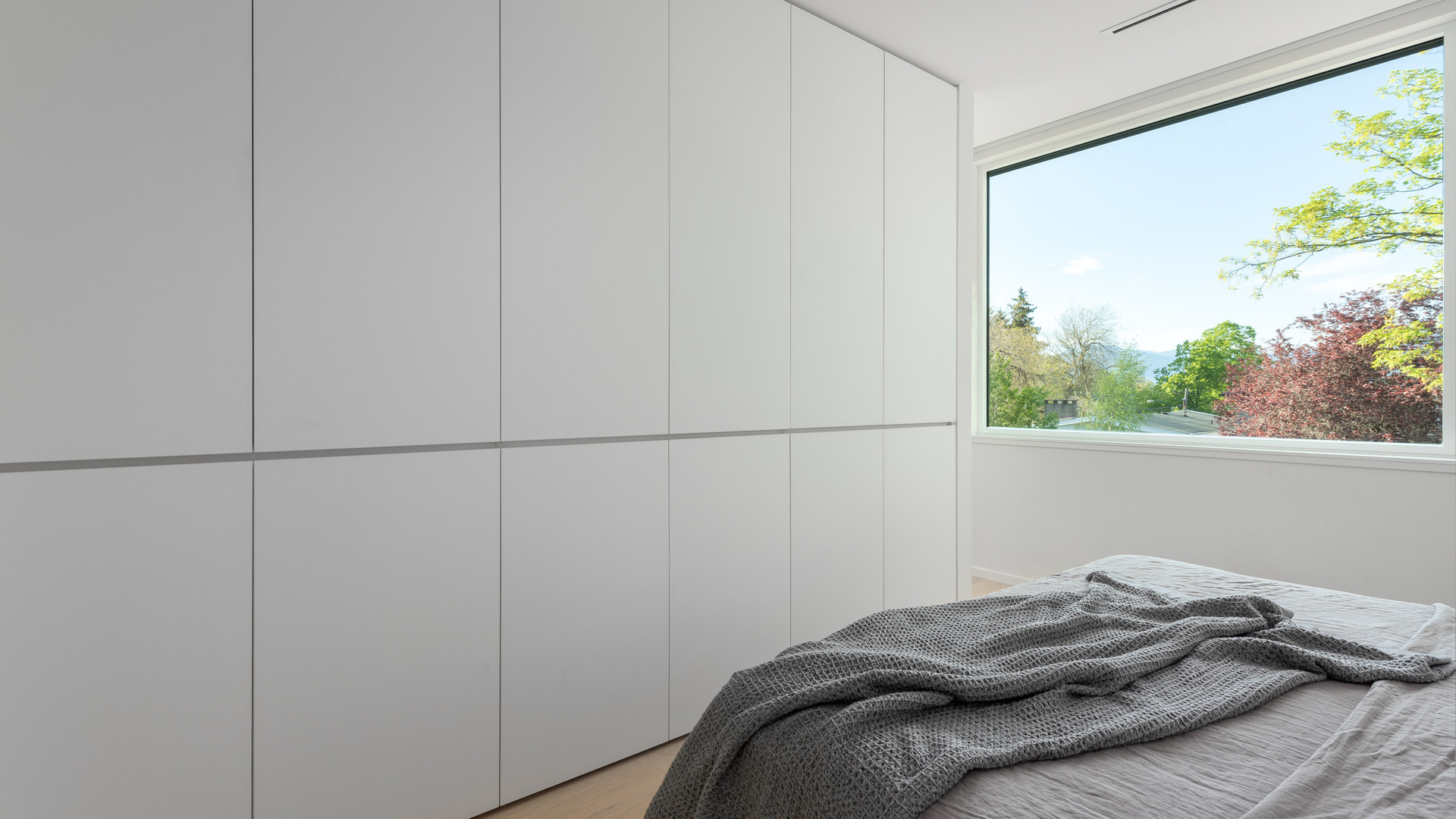 modern bedroom with millwork storage by untitled design agency