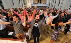 church congregation praying