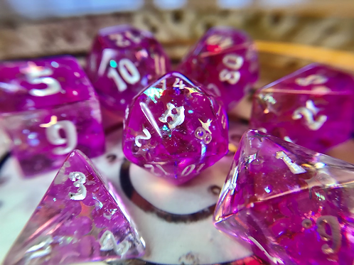 Pink and clear starburst- 7pc dice set