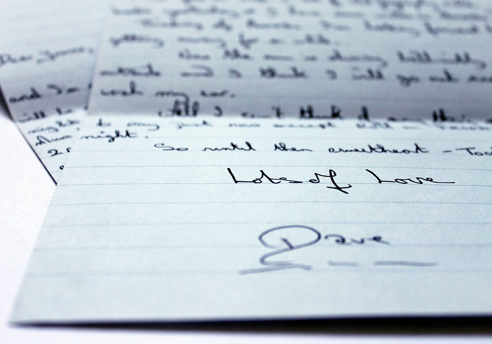 A close up of handwritten letter signed Love of Love.