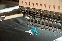 embroidery machine stitching a logo .jpg