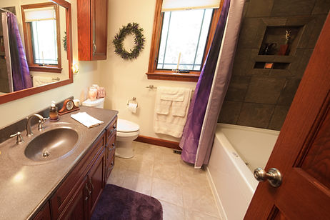 Bathroom with tile tub