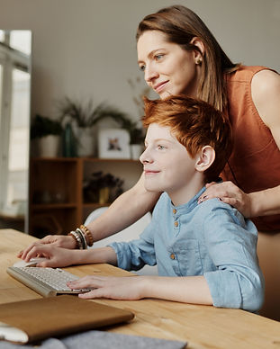 Canva - Photo of Woman Teaching His Son