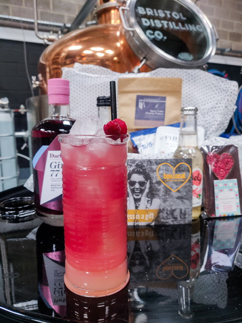 Picture of BDC Dark Berry Gin 77 in front of a Boxlocal Gift Box