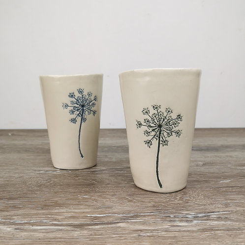 Tall porcelain tumbler with Queen Ann's lace imprint