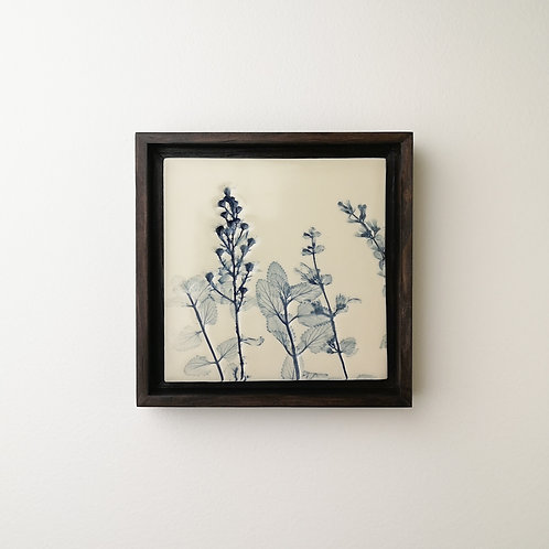 Small framed botanical art tile in blue