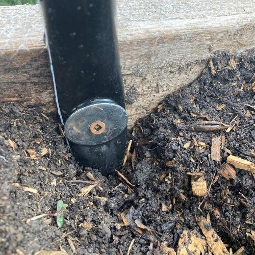 Find out how to build a DIY row cover for your raised bed zone 3 backyard vegetable garden out of PVC pipe attached with a washer and screw.