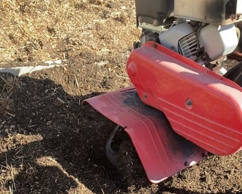 Loosening garden soil by rototilling is a good way of preparing soil for planting vegetables such as tomatoes and potatoes.