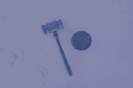 A%20wooden%20gavel%20on%20a%20white%20marble%20backdrop._edited.jpg