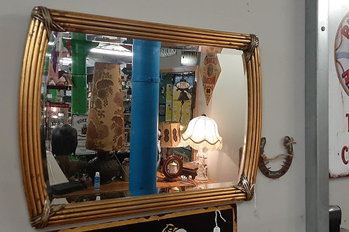 Rectangular Gold Colored mirror.